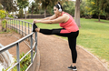 Curvy woman doing sport workout routine outdoor in city park - Focus on face - PhotoDune Item for Sale