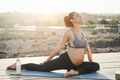 Young pregnant woman doing yoga outdoor - Meditation and maternity concept - PhotoDune Item for Sale