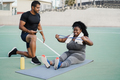 Curvy woman and personal trainer doing workout session outdoor - Main focus on girl face - PhotoDune Item for Sale