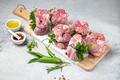 Pork Osso Buco, shin Pork shanks with fresh aromatic herbs on white marmol board - PhotoDune Item for Sale