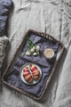 Breakfast tray on a bed. Croissant and coffee on bamboo tray on linen bedclothes - PhotoDune Item for Sale
