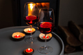 Two glasses of red wine front of fireplace. Romantic light - PhotoDune Item for Sale