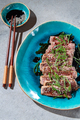 Beef tataki with sauce and sesame on blue plate. Japanese food - PhotoDune Item for Sale