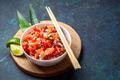 Lomi lomi salmon, hawaiian raw salmon salad on blue background - PhotoDune Item for Sale
