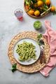 Pasta Lorighittas of Sardinia. Loriguittas with herb sauce pesto. in White plate. - PhotoDune Item for Sale