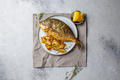 Grilled sea bream or dorada on gray plate. Gray background - PhotoDune Item for Sale