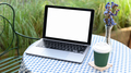 Mockup laptop blank screen on the cafe table with take away coffee mug. - PhotoDune Item for Sale