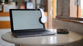 Mockup Laptop blank screen and headphone on screen, Laptop placed on a table in a cafe. - PhotoDune Item for Sale