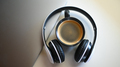 Coffee mug with laptop and headphone on placed on a table in a cafe,Coffee mug place in headphone. - PhotoDune Item for Sale