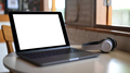 Mockup Laptop blank screen and headphone on placed on a table in a cafe. - PhotoDune Item for Sale