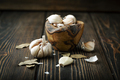 Garlic in a bowl on a wood background - PhotoDune Item for Sale