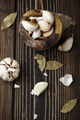 Garlic in a bowl with laurel leaves on a wooden background - PhotoDune Item for Sale