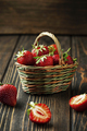 Sweet fresh strawberries in a basket on a wooden table - PhotoDune Item for Sale