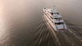 Low aerial view of large mega yacht crossing the ocean at sunrise. - PhotoDune Item for Sale