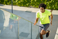 Black man running upstairs outdoors. Young male exercising - PhotoDune Item for Sale