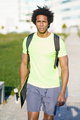 Black man going for a workout in sportswear and a skateboard - PhotoDune Item for Sale