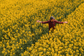 Aerial view of confident successful male farmer standing in blooming rapeseed field - PhotoDune Item for Sale