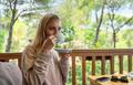 Woman Drinking Coffee on Terrace - PhotoDune Item for Sale