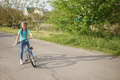 Girl riding a bicycle, happy summer in village, healthy lifestyle, childhood, sport and recreation - PhotoDune Item for Sale