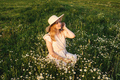 Beautiful young woman in hat on meadow. - PhotoDune Item for Sale
