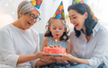 Grandmother, mother and daughter are celebrating birthday. - PhotoDune Item for Sale