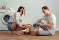 loving couple is doing laundry - PhotoDune Item for Sale