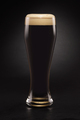 Mug with fresh stout beer with cap of foam on a black. - PhotoDune Item for Sale