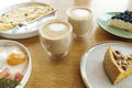 Bright breakfast, eggs, cups of coffee, desserts. - PhotoDune Item for Sale