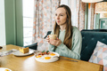 young beautiful woman have breakfast in cafe - PhotoDune Item for Sale
