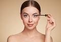 Beauty woman applying black mascara on eyelashes - PhotoDune Item for Sale