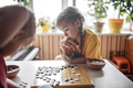 Sibling have fun together playing chess go at home, traditional Chinese board game, digital detox - PhotoDune Item for Sale