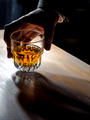 Man's hand holding a glass of whisky - PhotoDune Item for Sale