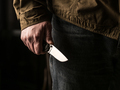 Man holding a knife in a threatening stance - PhotoDune Item for Sale