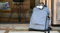 Tourist backpack and headphones on the road while waiting for the car, Travel concept. - PhotoDune Item for Sale