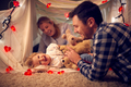 Laughing Parents With Young Daughter Having Fun In Homemade Camp In Child's Bedroom At Home - PhotoDune Item for Sale