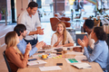 Colleagues Celebrating Businesswoman's Birthday At Meeting Around Table In Modern Open Plan Office - PhotoDune Item for Sale