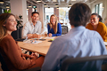 Business Team Having Meeting Sitting Around Table In Modern Open Plan Office - PhotoDune Item for Sale