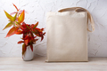 Rustic tote bag mockup with red grass in the vase - PhotoDune Item for Sale