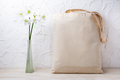 Rustic tote bag mockup with white lilies in the vase - PhotoDune Item for Sale
