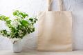 Rustic tote bag mockup with  flowering apple tree branch - PhotoDune Item for Sale