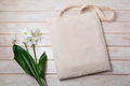 Rustic tote bag mockup with white lily - PhotoDune Item for Sale