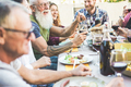 Happy family eating and drinking wine at barbecue dinner on patio outdoor - PhotoDune Item for Sale