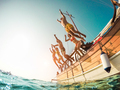 Group of happy friends diving from sailing boat into the sea - PhotoDune Item for Sale