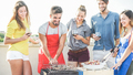 Happy friends cooking meat and drinking red wine at barbecue patio party - PhotoDune Item for Sale