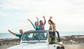 Happy tourists friends doing excursion on desert beach in convertible 4x4 car - PhotoDune Item for Sale