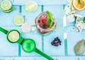 Top view of berries mojito on blue wood bar counter with lime squeezer and tropical fruit - PhotoDune Item for Sale