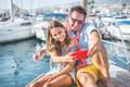 Happy father and daughter taking a selfie on sailboat during ocean trip vacation - PhotoDune Item for Sale