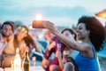 Happy friends taking selfie with smartphone at beach party outdoor - PhotoDune Item for Sale