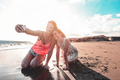 Mother and daughter having fun on tropical beach - PhotoDune Item for Sale