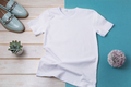 Women white T-shirt mockup with turquoise loafers - PhotoDune Item for Sale